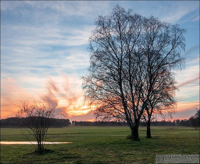 Solnedgång mellan Klingvalla och Torna Hällestad